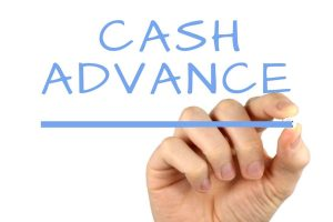 Cash advance written in light blue on a reverse window